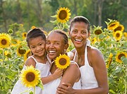 African American grandmother, mother and daughter with sunflowers