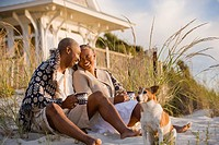Senior African American couple sitting on beach