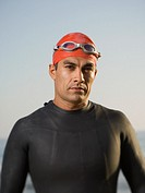 Hispanic man wearing wetsuit and goggles