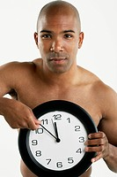 African American man holding clock