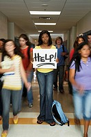 African American teenaged student holding Help sign