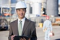 Asian businessman wearing hardhat