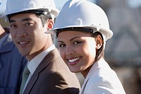 Multi-ethnic businesspeople wearing hardhats