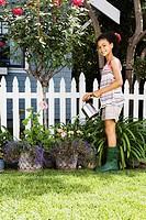 Gardening girl watering plants