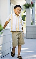 Hispanic boy standing on porch
