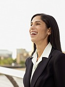 Hispanic businesswoman laughing
