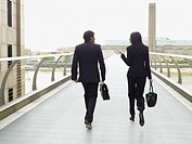 Multi-ethnic businesspeople walking on skyway
