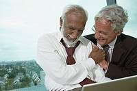Two businessmen laughing