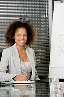 African businesswoman at conference table