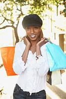 African woman holding shopping bags