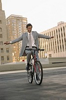 Businessman on a bicycle (thumbnail)