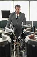 Businessman with row of computers