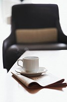 Coffee cup and office chair