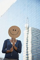 Businesswoman holding smiley face