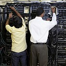Information technologists working on servers (thumbnail)