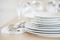 Plates, forks, and napkins on kitchen counter (thumbnail)