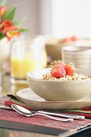 Oatmeal and strawberries in bowl