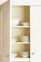 Fine china in kitchen cabinet