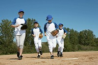 Boys running with baseball gloves