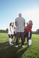Referee talking to soccer teams
