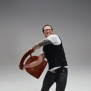 Man throwing chair