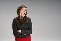 Young woman yawning (thumbnail)