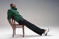 Man reclining on a chair
