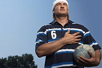 Rugby player with hand over heart