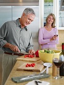 Couple in kitchen preparing meal