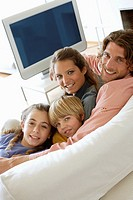 Family in living room on sofa bonding