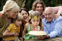 Young girl celebrating birthday with family