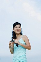 Woman outdoors holding digital camera