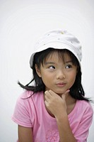 Young girl indoors thinking (thumbnail)