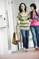 Two women outdoors with shopping bags