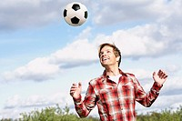 Man outdoors with soccer ball