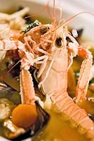 Two Norway lobsters in vegetable stock
