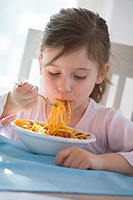 Girl eating spaghetti bolognese