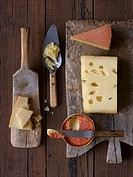 Five different types of cheese on wooden boards