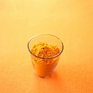 Ground turmeric in a glass