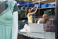 Two employees working in clothes shop