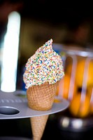Ice cream cone with sprinkles in metal holder