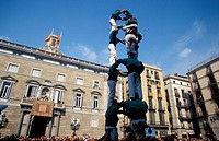 ´Castellers´, human tower, arising in front of town hall during the Mercé festival. Barcelona. Spain