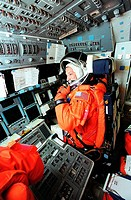 06/29/2001 __ Inside Space Shuttle Atlantis, Pilot Charles O. Hobaugh looks at Commander Steven W. Lindsey as they get ready for a simulated countdown...