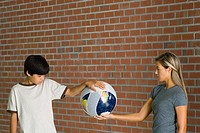 Boy and woman holding bandaged globe together