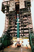 06/03/1999 ___ At Launch Pad 17A, Cape Canaveral Air Station CCAS, the first stage of a Boeing Delta II rocket is ready to be lifted into the tower. T...