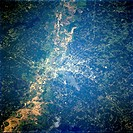 Shreveport and the Red River Valley, with its reddish_brown agricultural fields, are prominent in this low_oblique, southeast_looking photograph. With...