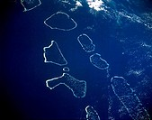 This south_looking, low_oblique photograph shows from north to south the Ari, Male, Felidu, Nilande, Mulaku, and Kolumadulu Atolls of the Maldives. Th...