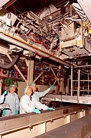 09/06/2001 __ From a vantage point below it, members of the STS_110 crew check out Integrated Truss Structure ITS S0, which is in the Operations and C...
