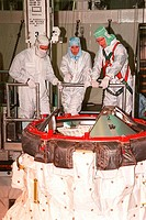 09/03/1999 ___ In the payload bay of the orbiter Discovery, STS_103 Mission Specialists John M. Grunsfeld Ph.D., left, and Claude Nicollier of Switzer...