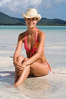Portrait of woman in bikini and cowboy hat. Whitehaven Beach, Australia